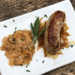 Heritage Pork Sausages with Caramelized Onions and Sage Pear Sauce